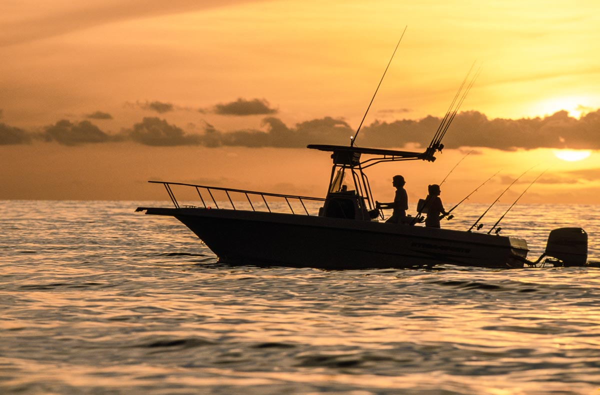 sunset fishing boat photography